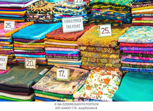 Composed Roll shaped stacked Traditional colorful silk ,cashmere head scarves or shawls and fabrics for sale in Grand Bazaar,Istanbul,Turkey