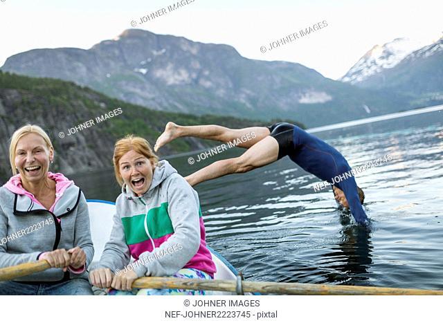 Happy women in rowing boat
