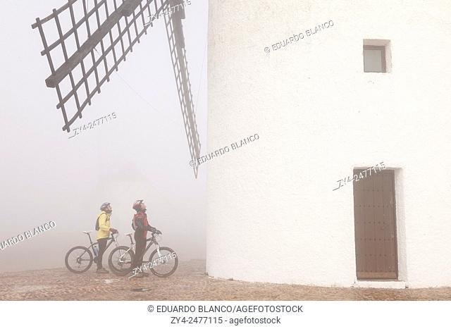 MIlls and bikers. Alcazar de San Juan. Ciudad Real. La Mancha. Spain. Europe