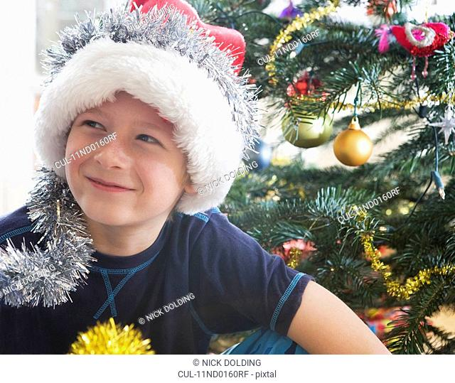 Boy, 10 with Christmas decorations
