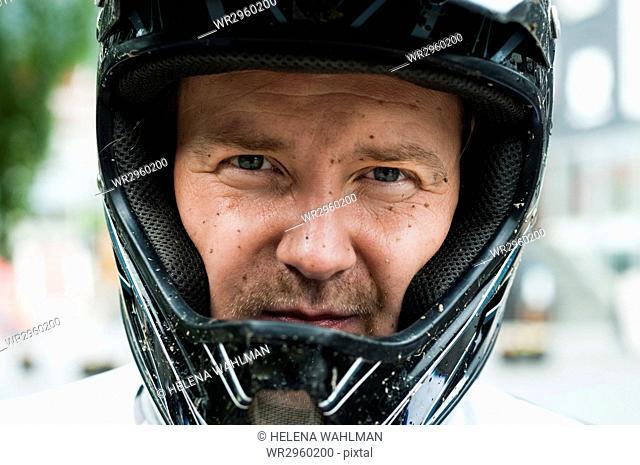 Man in safety helmet looking at camera