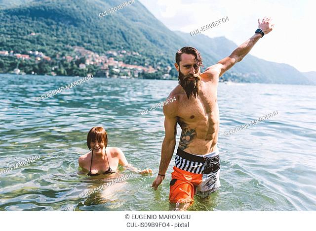 Portrait of young hipster couple in lake Como, Como, Lombardy, Italy