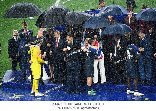 Umbrella award ceremony: left to right goalkeeper Hugo Lloris (France), Giovanni Infantino (FIFA President), Vladimir Putin (President of Russia)