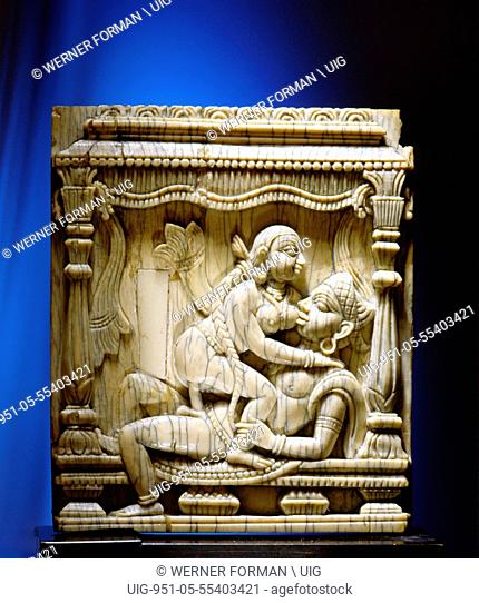 An ivory panel probably from a bed or a swing carved with a tantric scene of a couple making love