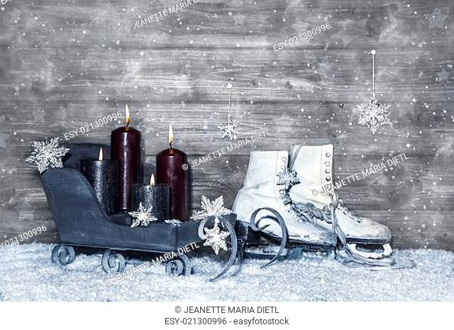 Grey shabby chic christmas background of wood with four burning candles