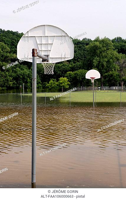Flooded outdoor basketball court