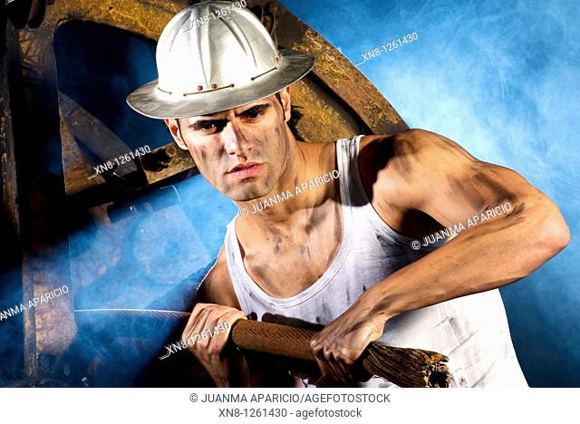 Representation of a worker with aluminum hull pulling a steel cable in a smoky atmosphere