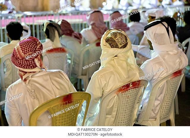 Qatar - Doha - Souq Waqif - Qatari attending an outdoor concert
