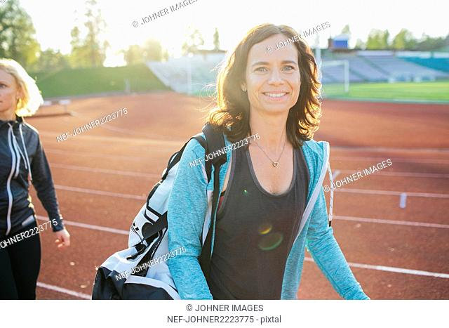 Smiling woman on running track