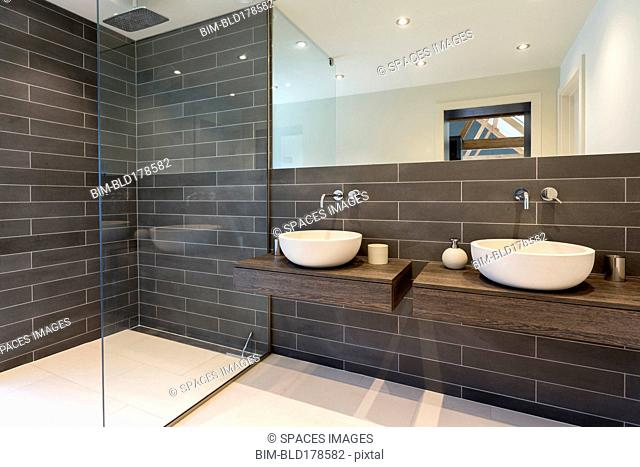 Sinks and shower in modern bathroom