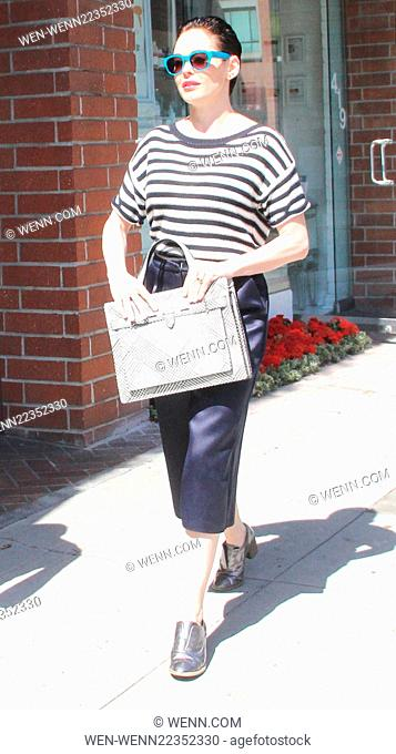 Rose McGowan wearing a stripped top and knee length black leather shorts, running errands in Beverly Hills Featuring: Rose McGowan Where: Los Angeles