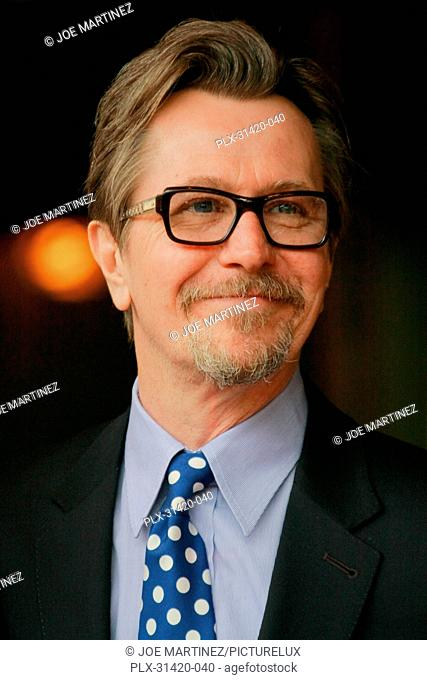 Gary Oldman at the Hollywood Chamber of Commerce ceremony to honor Malcolm McDowell with a star on the Hollywood Walk of Fame in Hollywood, CA, March 16,2012