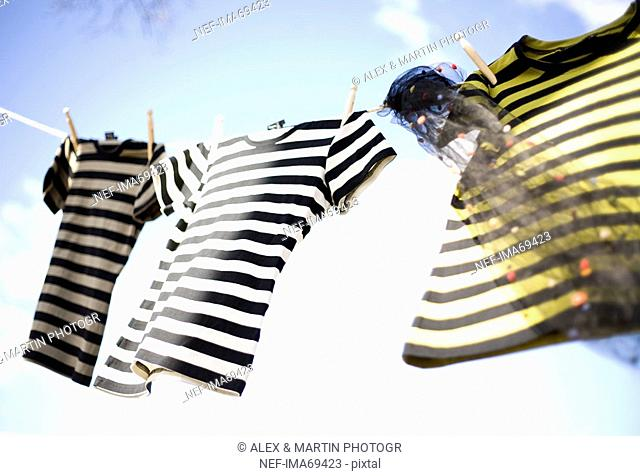 Three striped t-shirts hanging out to dry, Sweden