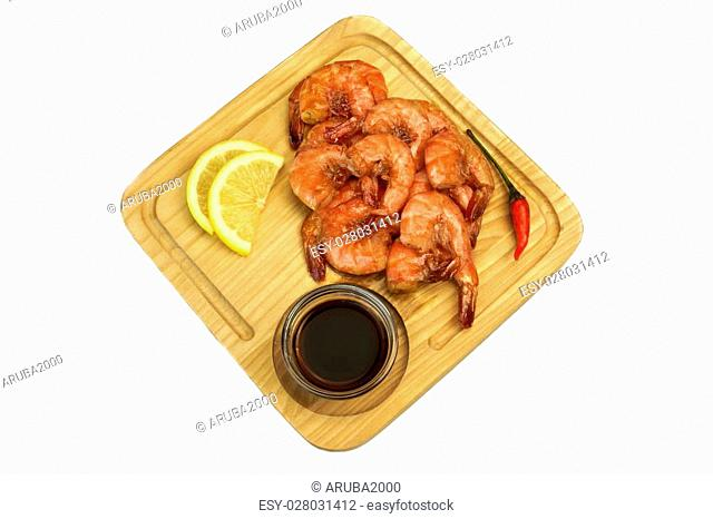Grilled Red King Size Shrimps Or Prawns With Sauce, Chili Pepper and Lemon, Served On Wood Board Isolated On White Background, Close Up, Top View