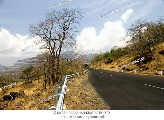 Mountain roads in summer national highway no 222 at malshej ghat ; Maharashtra ; India