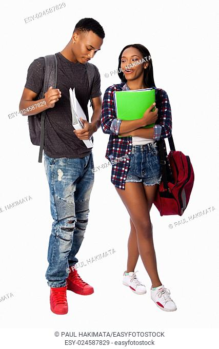 Happy smiling students standing together having fun talking joking carrying book bag backpack notepads, on white