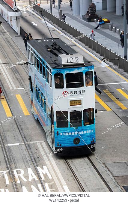 Old double-decked streetcars provide transit service in Central District. Hong Kong Island, Hong Kong