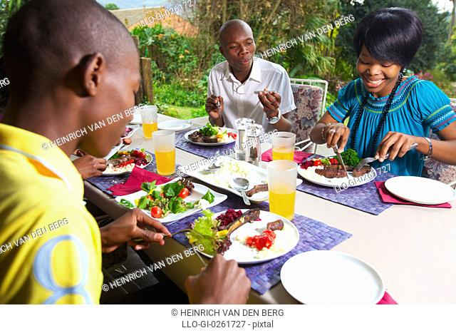 Young people eating braai meat and salads, KwaZulu-Natal, South Africa