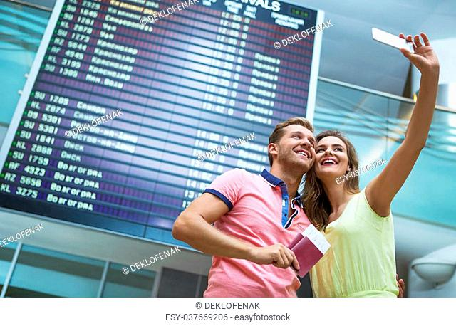 Young couple making selfie at the airport