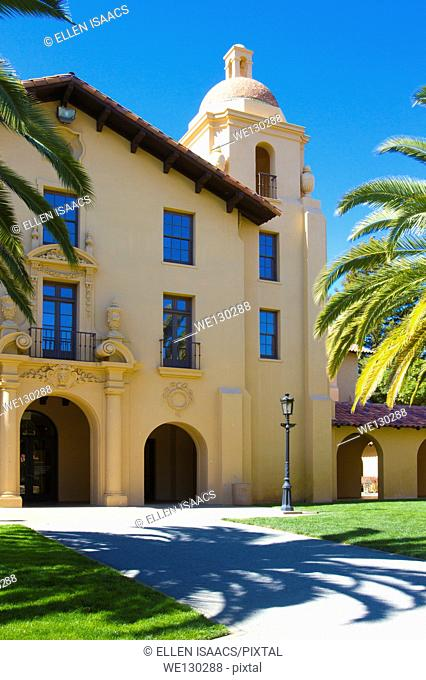 Old Union Building with shadow of palm tree on Stanford University campus