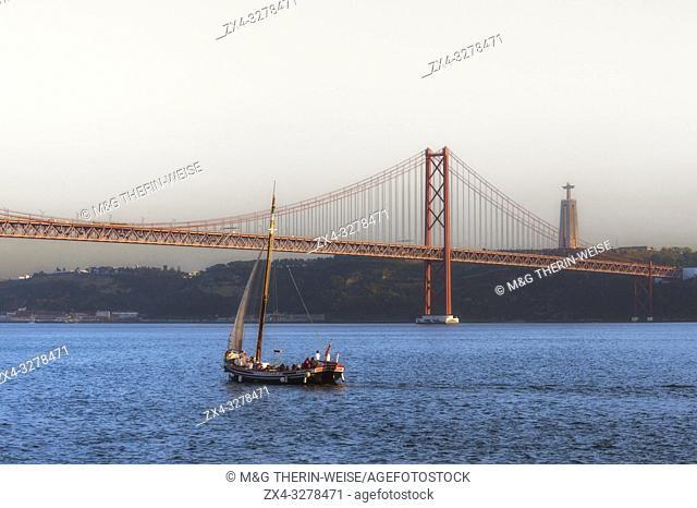 Bridge of 25 April and Almada Cristo Rei statue Belem district, Lisbon, Portugal