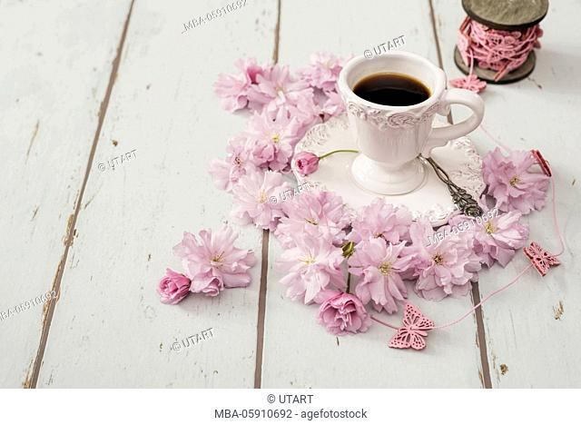Cup, coffee, silver spoon, wooden board,Japanese cherry blossoms, reel of thread, thread, pink, to butterflies