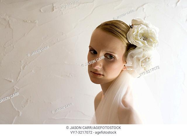 Caucasian female model poses for wedding pictures in the studio