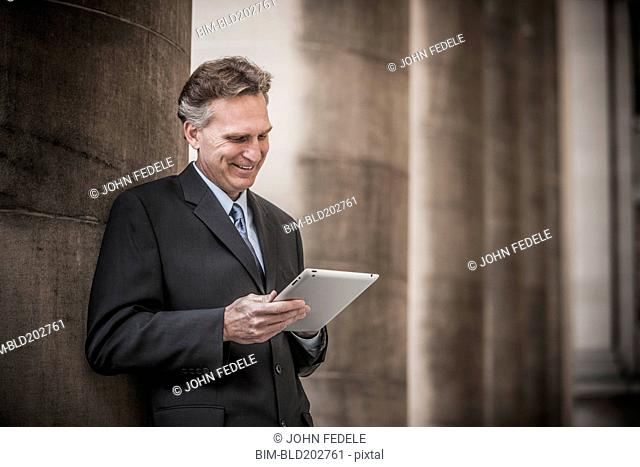 Caucasian businessman using tablet computer