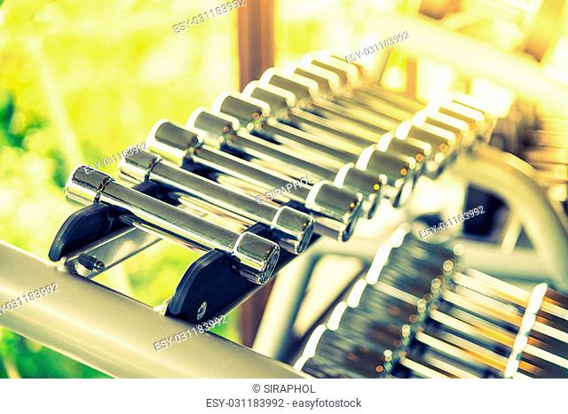 Selective soft focus point on Dumbbell - vintage filter and sunflare effect