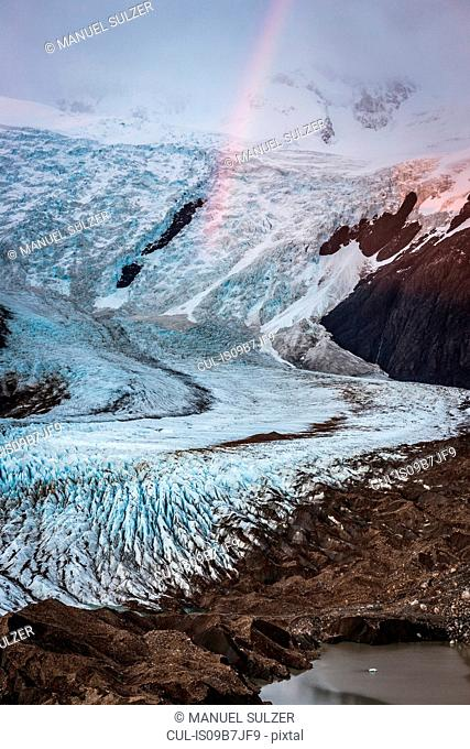 Rainbow and low cloud over Torre glacier in Los Glaciares National Park, Patagonia, Argentina