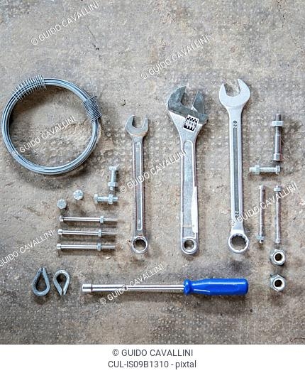 Nuts, screws, wrench, screwdriver
