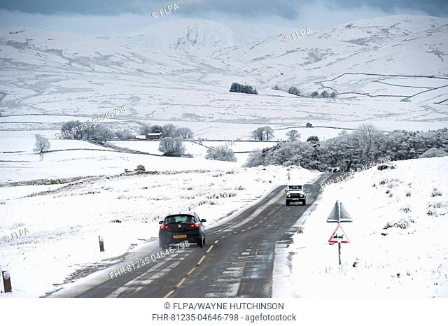 Traffic on road in snowy weather conditions, A683 between Kirkby Stephen and Sedbergh, Cumbria, England, December