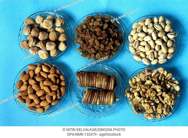 Pista ; Apricot ; Dry Fig ; Almond ; Walnut and Raisin ; Dry fruits for Diwali Festival ; Deepavali at Borivali ; Mumbai Bombay ; Maharashtra ; India