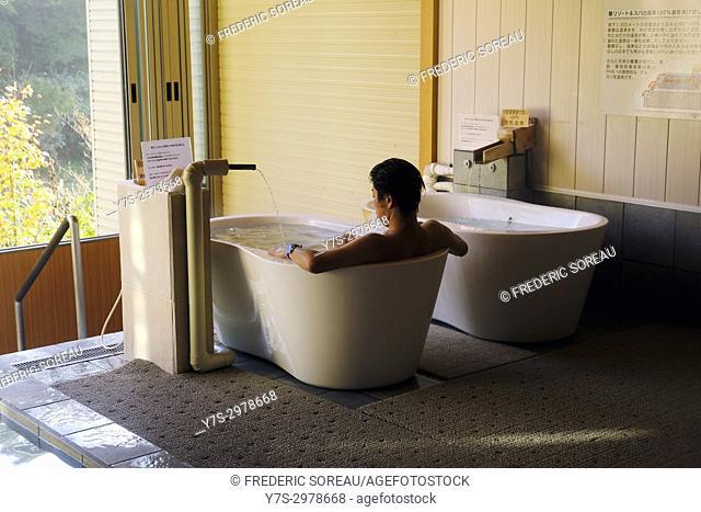 Japanese man relaxing in bath or onsen in Takayama, Japan, Asia