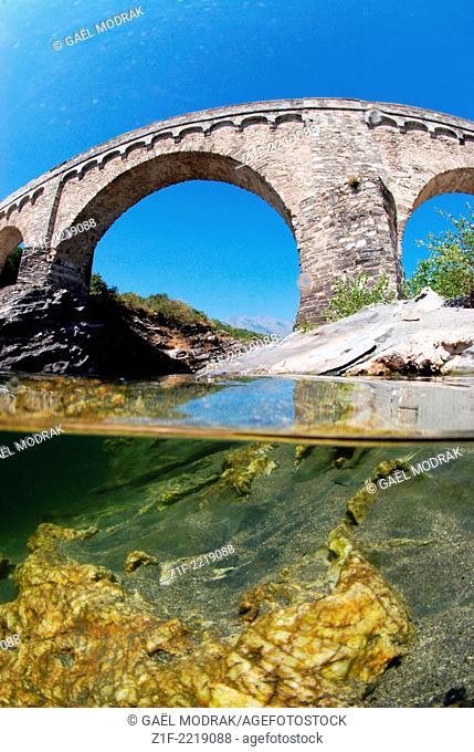 Bridge crossing over the Tavignano river in Corsica, France