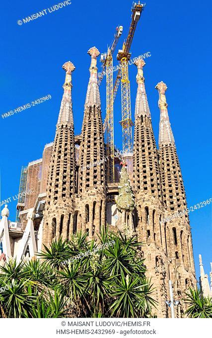 Spain, Catalonia, Barcelona, Eixample, the Sagrada Familia Basilica of the architect Antoni Gaudi, whose work began in 1882 and its Nativity facade listed as...