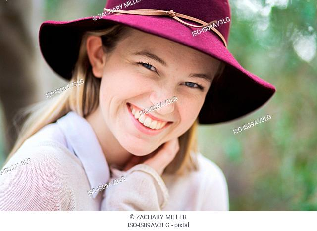 Portrait of young woman, smiling, outdoors