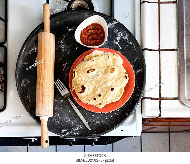 Platter of tortillas, salsa and rolling pin