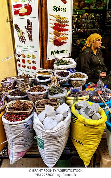 A Local Woman Sells Spices and Herbs From A Shop In The Medina, Fez el Bali, Fez, Morocco
