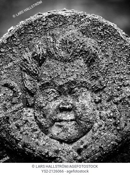 Face of cherub on ancient tomb, Sweden