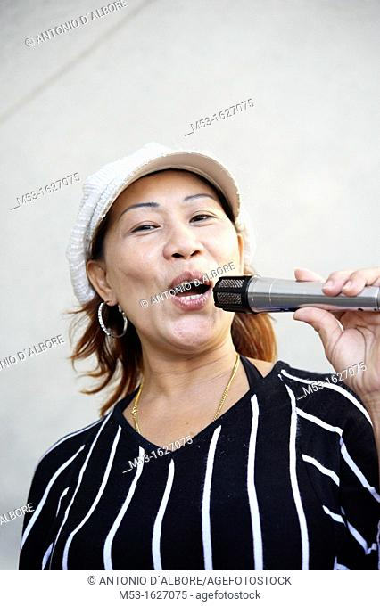 A singaporean woman singing under Esplanade bridge  Singapore