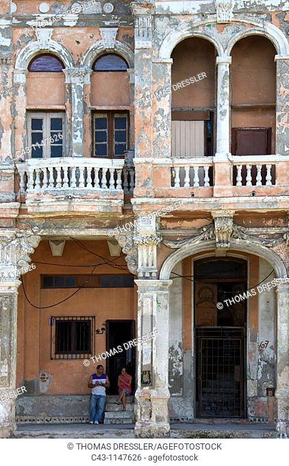 Cuba - Many buildings and their façades at the Malecón, the famous oceanfront promenade of Cuba's capital Havana, are in quite a bad state