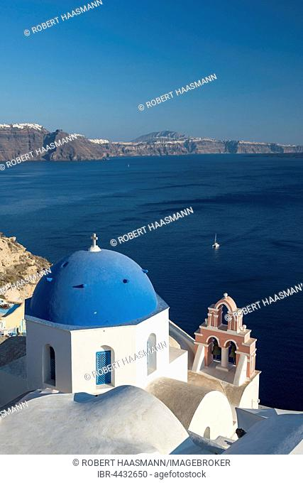 Orthodox church with blue dome and bell tower, Oia, Santorini, Cyclades, Greece