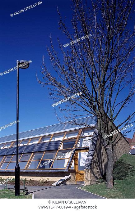 BURGESS PARK FOOTBALL PAVILION, BURGESS PARK, LONDON, SE5 CAMBERWELL, UK, STUDIO E ARCHITECTS LTD, EXTERIOR, DETAIL OF PHOTOVOLTAIC CELLS WINDOWS AND EXIT, DAY