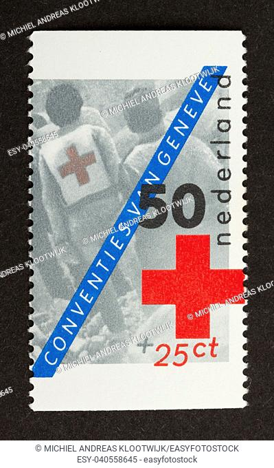 HOLLAND - CIRCA 1980: Stamp printed in the Netherlands shows a red cross, circa 1980