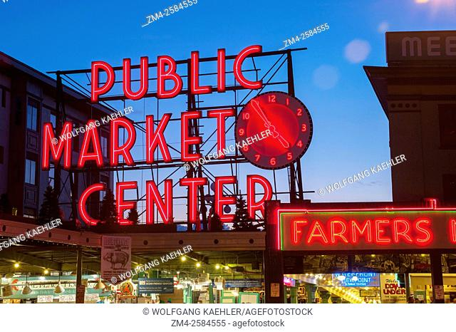 A night photo of the neon sign over the main entrance to the Pike Place Market in Seattle, Washington State, USA