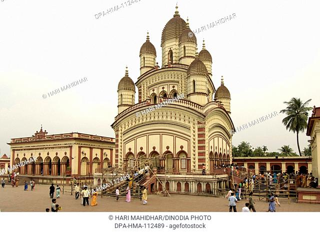 Pilgrims visited Dakshineshwar Kali Temple classic bengali hut style built in 1847 surrounded by twelve Shiva temples ; Calcutta now Kolkata ; West Bengal ;...