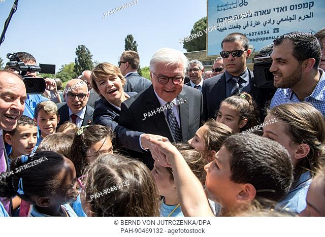 The German president Frank-Walter Steinmeier (C) and his wife Elke buedenbender (on Steinmeier's right) visit the Givat Haviva education centre in Menashe