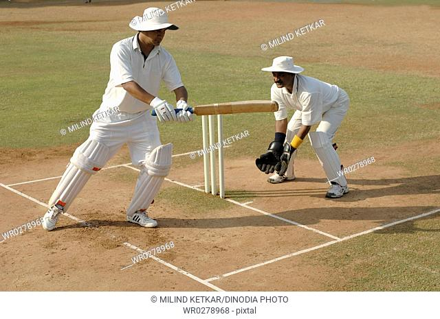 Indian left handed batsman in action playing square cut shot in cricket match MR705L