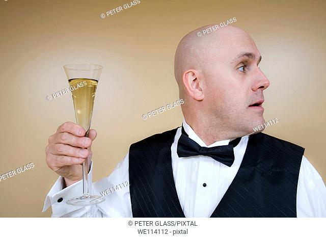 Middle-age bald man with a glass of champagne